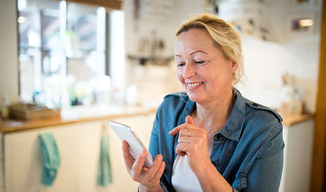 woman interacting with her smart phone