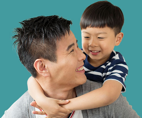 father and son smiling at each outher