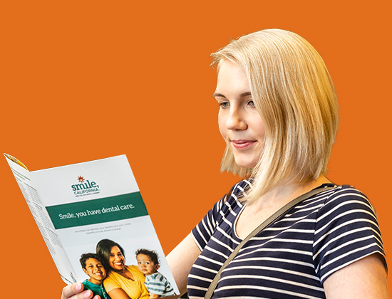 woman reading brochure